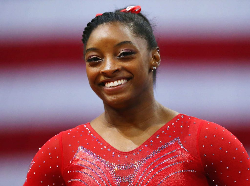 simone biles to vacation in belize
